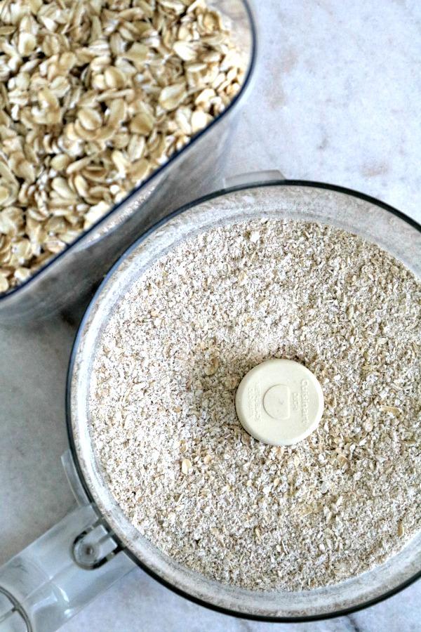 Oat flour in food processor bowl.
